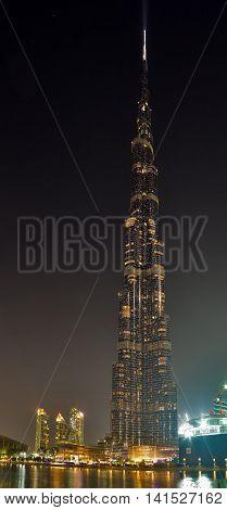 DUBAI UAE - JANUARY 23 2016: Vertical night panorama of Burj Khalifa tallest building in the world 829.8 m. Dubai Burj Khalifa United Arab Emirates