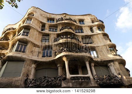 BARCELONA SPAIN - AUGUST 24: Casa Mila facade of the art house made by the architect Antonio Gaudi on August 24 2012 in Barcelona Spain