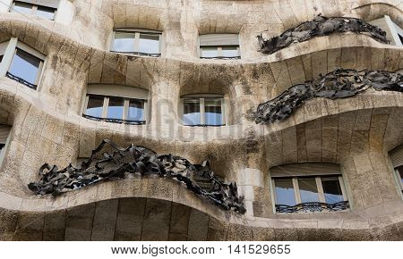 BARCELONA SPAIN - AUGUST 24: Casa Mila details of the facade of the house made by the Catalan architect Antonio Gaudi August 24 2012 in Barcelona Spain