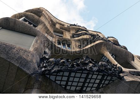 BARCELONA SPAIN - AUGUST 24: Modernism style architecture. Casa Mila aka La Pedrera (Catalan for 'The Quarry') on August 24 2012. This famous building was designed by Antoni Gaudi 1906 - 1910.