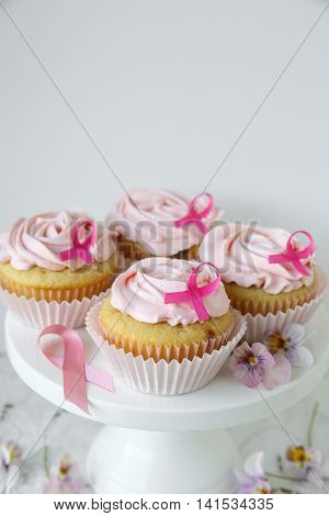 Rose flower cupcakes for pink ribbon day copy space background Breast cancer awareness