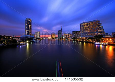 Abstract blurred Background of Light effects over time after sunset on the river : Bangkok city, Thailand.