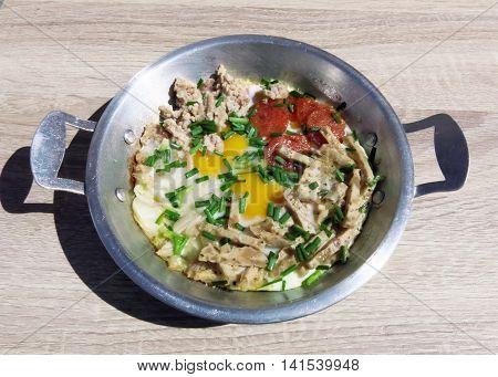 Indochina pan-fried egg with toppings : Vietnamese pork role Pork sausage Pork chop Shallot Chili sauce Ketchup Seasoning etc.