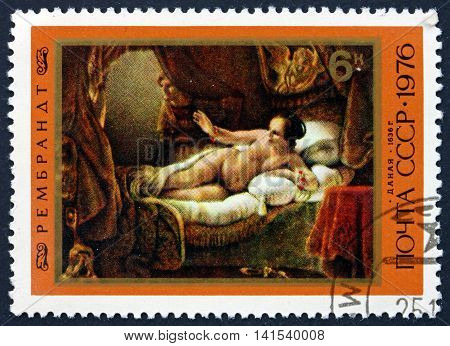 RUSSIA - CIRCA 1976: a stamp printed in the Russia shows Danae Painting by Rembrandt Dutch Painter and Etcher circa 1976