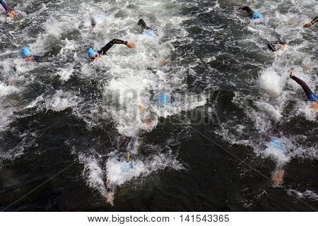 FREDERICIA DENMARK - AUGUST 6 2016: Triathletes just after start of the triathlon competition Challenge Denmark in Fredericia August 6 2016.