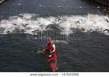 FREDERICIA DENMARK - AUGUST 6 2016: Triathletes on start of the triathlon competition Challenge Denmark in Fredericia August 6 2016.