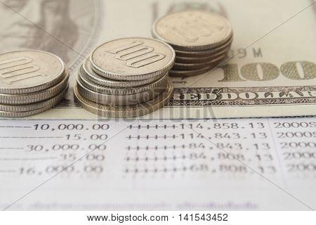 notebook bank passbook report money deposit and coins