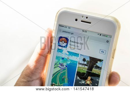 Rayong, Thailand - August 7, 2016 : Apple iPhone6 held in one hand. User install Pokemon Go, a free-to-play augmented reality mobile game developed by Niantic for iOS and Android devices (select focus).augmented reality mobile game developed by Niantic fo