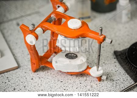 Articulator equipment in dental laboratory, dental concept
