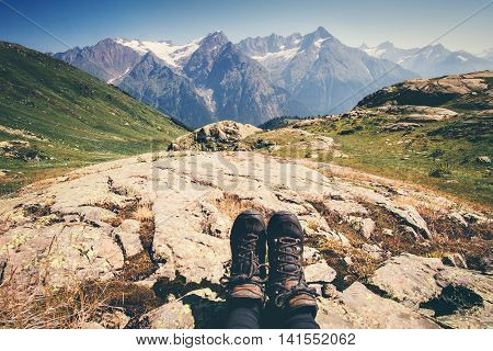 Feet trekking boots hiker with mountains landscape outdoor Travel Lifestyle concept active Summer vacations adventure