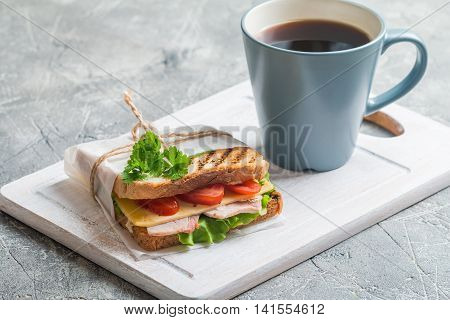 Breakfast and Lunch - Sandwich and Coffee on cutting boad