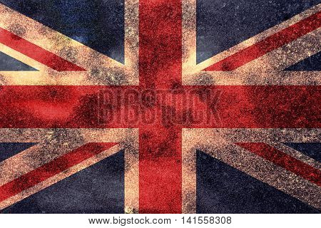 The Great Britain Union Jack flag worn vintage background.