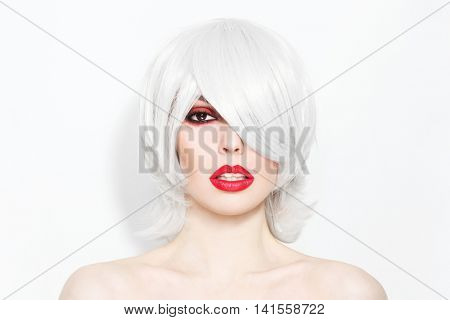 Portrait of young beautiful woman with choppy lob with fringe and stylish make-up