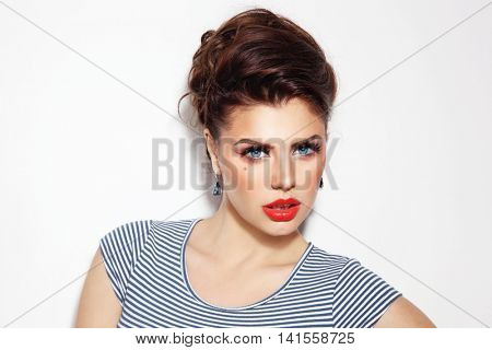 Portrait of young beautiful girl with pin-up style make-up and hairdo