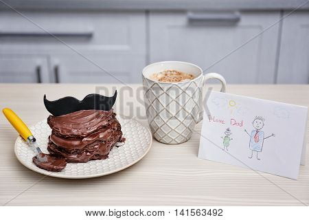Chocolate pancakes with mustache and coffee on table. Happy fathers day concept