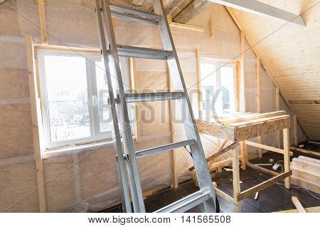 Heat Insulation And Wooden Logs Lathing Ready For Making Finishing. An Interior View Of Unfinished H