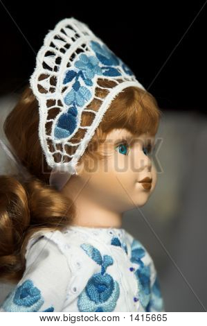 Doll In Folk Costume With Blue Traditional Embroidery In Hungary.
