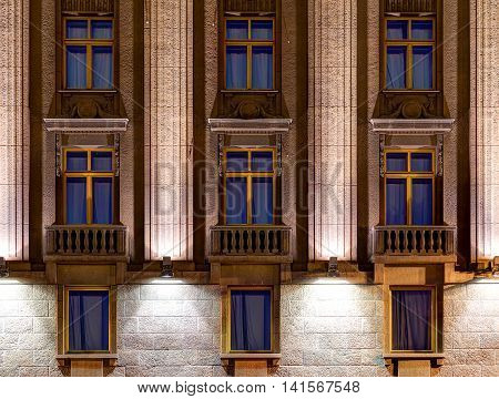 Several windows in a row on night illuminated facade of Hotel Astoria front view St. Petersburg Russia