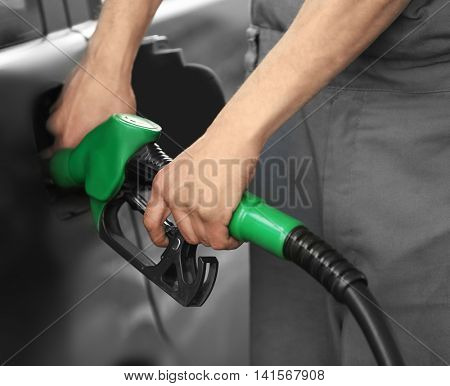 Car refueling on petrol station