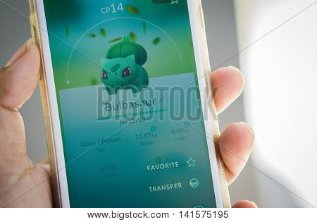 Rayong, Thailand - August 7, 2016 : Apple iPhone6 held in one hand showing its screen with Pokemon Go application. - select focus