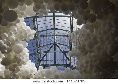 LONDON, UNITED KINGDOM - SEPTEMBER 12 2015: Close up of Heartbeat Art installation in Covent Garden market in London done with houndreds of white balloons