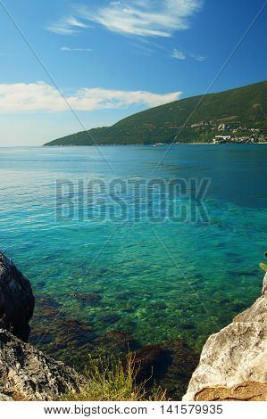 Bright and clean Adriatic sea of Boka Bay in Montenegro