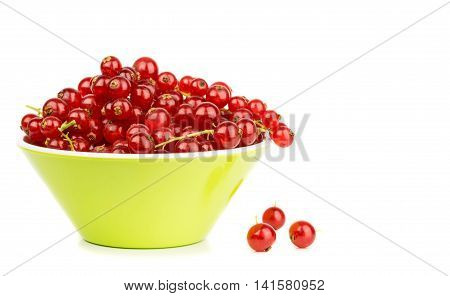 A bowl of red currants on a white background