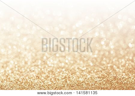 Abstract glitter gold background with white copy space