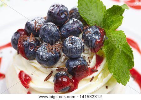 Meringue cake Pavlova with blueberry