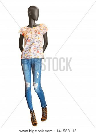 Female mannequin dressed in jeans and floral t-shirt isolated on white background. No brand names or copyright objects. poster