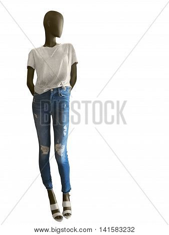 Full-length female mannequin dressed in t-shirt and blue jeans isolated on white background. No brand names or copyright objects.