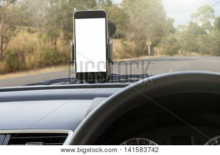 phone and mounted holder in car on rural road