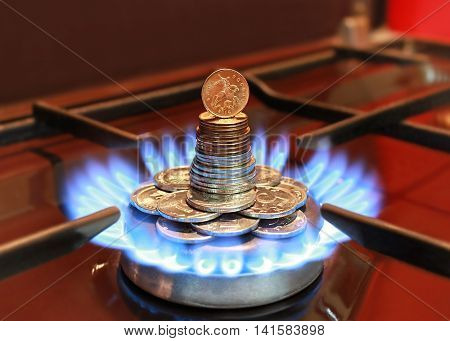 Gas burner with blue flame and coins