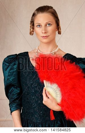 portrait victorian woman with a red feather  fan