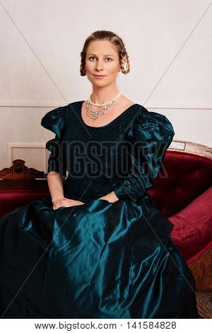 portrait young victorian woman in green dress