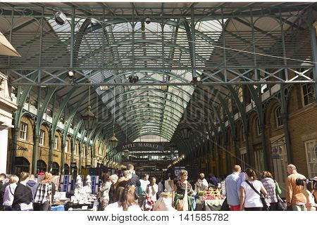LONDON, UNITED KINGDOM - SEPTEMBER 12 2015: Crowd of people in front of Covent Garden Market entrance in London United Kingdom
