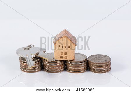 House and coins stack , saving and realestate concept