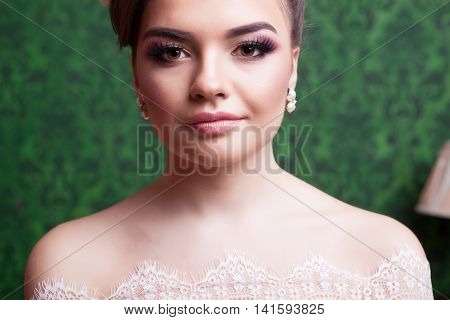 Brides Portrait On Green Vintage Background