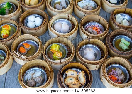 various dim sum in bamboo steamer in chinese restaurant