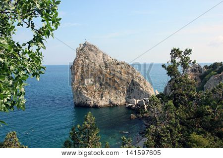 view on beautiful rock Diva on the coast of Black sea and turquise water near Simeiz in Crimea
