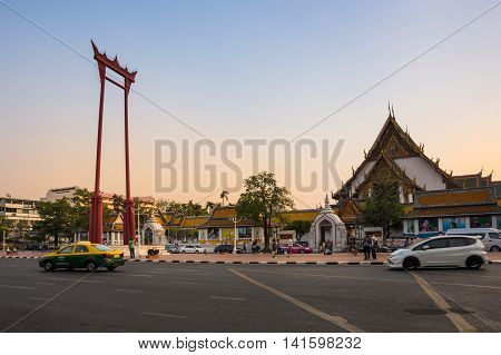 BANGKOK THAILAND - JANUARY 25 2015: The Giant Swing and Suthat Temple at twilight time in Bangkok Thailand