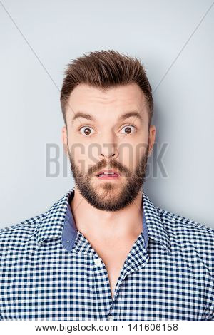 It's Unbelievable! Portrait Of Young Handsome Shocked Man