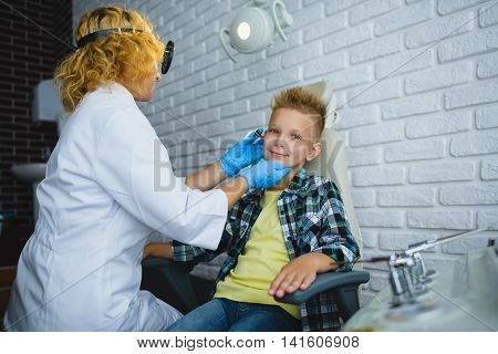 Ent doctor or Otolaryngologist examining a kid ear.