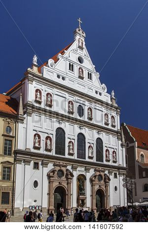 MUNICH, GERMANY - AUGUST 29, 2015: St. Michael is a Jesuit church in the inner city of Munich and one of the largest Renaissance churches in Europe unidentified people are walking along