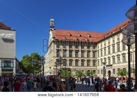 MUNICH, GERMANY - AUGUST 29, 2015: The shopping mile Kaufinger street is located in the inner city of Munich between Marienplatz and Karlsplatz (Stachus) unidentified eople walking along the small stores