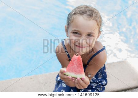 Smiling Little Girl With Fruit In Hand