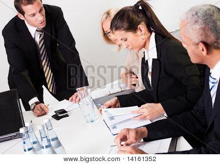 Businesswomen taking notes at the presentation