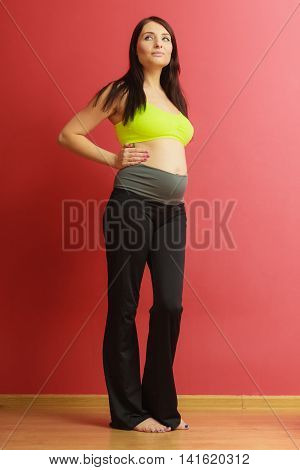 Long Hair Fit Pregnant Woman On Red