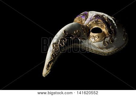 Beautiful venetian souvenir mask on black background poster