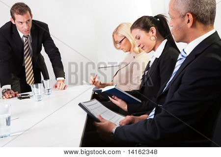 Team of business people taking notes